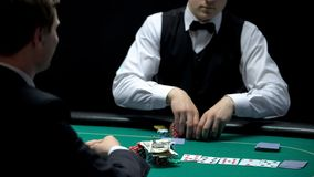 Casino croupier matching bet of player going all-in, betting all money and keys. Stock photo royalty free stock photos