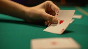 Casino croupier turning over ace of heart, lucky sign in poker and blackjack. Stock footage stock video