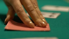 Casino croupier turning over ace of hearts, fortune sign in poker game, victory. Stock footage stock footage