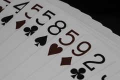 Casino de tisonnier jouant des cartes Image stock