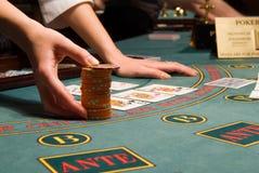 Casino dealer handling a big pile of chips Stock Image