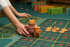 Casino dealer handling a big pile of chips Royalty Free Stock Image