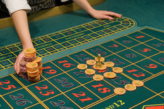 Casino dealer handling a big pile of chips Stock Photo