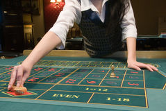 Casino dealer handling gambling chips Stock Photography