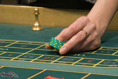 Casino dealer handling gambling chips Stock Photos