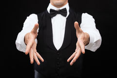 Casino dealer showing trick. Magic, performance, circus, casino and show concept - casino dealer showing trick Royalty Free Stock Image