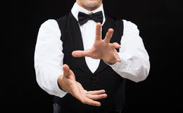 Casino dealer showing trick. Magic, performance, circus, casino and show concept - casino dealer showing trick Royalty Free Stock Photos
