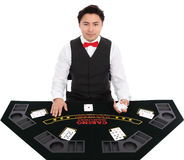 Casino dealer in vest and tie Royalty Free Stock Image