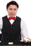 Casino dealer in vest and tie Stock Photos