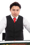 Casino dealer in vest and tie Royalty Free Stock Images