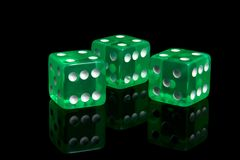 Casino dice. Three casino dice on a black background Royalty Free Stock Photos