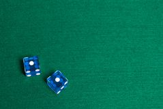 Casino Dice. Blue Casino Dice with Snake Eyes on the side for text royalty free stock photos