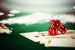 Casino dice with poker chips in gamble green table. Stock Photo
