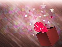 Casino Dice and stars coming out from a box Stock Images
