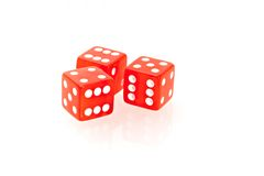 Casino dice. Three red casino dice on a white background Stock Photos