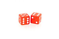 Casino dice. Two red casino dice on a white background Royalty Free Stock Images