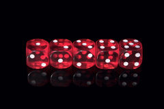 Casino dices. Five red casino dices on the black background Royalty Free Stock Image