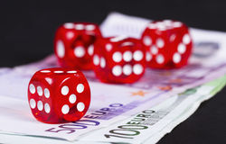 Casino dices over money Royalty Free Stock Images