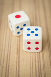Casino dices. On wooden background Royalty Free Stock Images