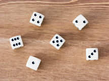 Casino dices. On a wooden table. Straight Stock Photos