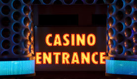 Casino Entrance Sign. At night with copy space above words royalty free stock photography