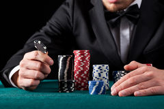 Casino gambler with chips Stock Photography