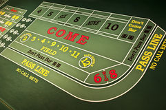 Casino Gambling Gaming Craps Table Game. Feeling lucky? Put your money down and gamble your hard earned cash with this popular dice game! The green felt of a Royalty Free Stock Photos