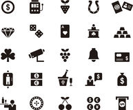 Casino and gambling icon set. Set of black and white glyph flat icons relating to casino and gambling Royalty Free Stock Photos