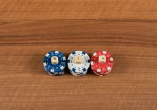 Casino game chips and label on a wooden board stock image