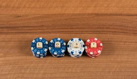 Casino game chips and label on a wooden board stock photos