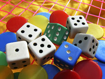 Casino Games. Dice and pawns from a board game Stock Image