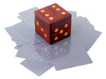 Casino games. Dice on cards texture scattered , isolated on a white background Stock Images
