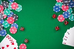 Casino games related items on green table, copy space.  stock image