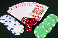 Casino gaming. Casino american roulette table with various chips and red dices Royalty Free Stock Images
