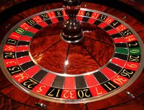 Casino roulette wheel. Casino gaming roulette table wheel showing numbers royalty free stock images
