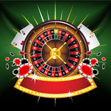 Casino gold-framed composition with roulette wheel. On green background Royalty Free Stock Images