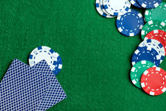 Casino green table with chips and play cards Royalty Free Stock Photo