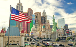 Casino and hotel New York New York along with Las Vegas strip and US flag fluttering Stock Photos