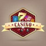 Casino  illustration with ribbon, chips, dice, card and lucky seven symbol. Royalty Free Stock Photo