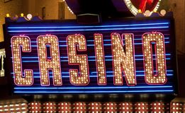 Casino Lights. Retro racing light and neon Casino sign at night Royalty Free Stock Photo