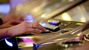 Casino: man and woman playing slot machines. close-up.  stock video footage