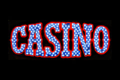 Casino Neon Sign. Red white and blue neon casino sign royalty free stock photo
