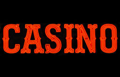 Casino Neon Sign. Red casino neon sign isolated on black Stock Image