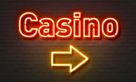 Casino neon sign on brick wall background. Royalty Free Stock Images