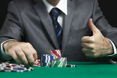 Casino Nightlife. Blackjack In A Casino Man Wins Gets Rich, Shows A Big Like Royalty Free Stock Photography