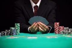 Casino Nightlife. Casino worker holds cards, blackjack game Stock Image
