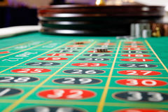 Casino no tokens roulette wheel. Green table Stock Images