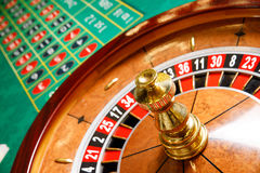 Casino no tokens roulette wheel. Green table Royalty Free Stock Images