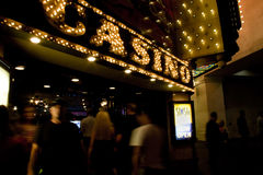 Casino. Picture of Las Vegas casino sign at night with people walking in and out Royalty Free Stock Images