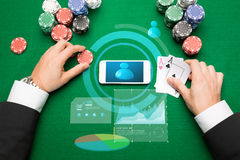 Casino player with cards, smartphone and chips Royalty Free Stock Photography